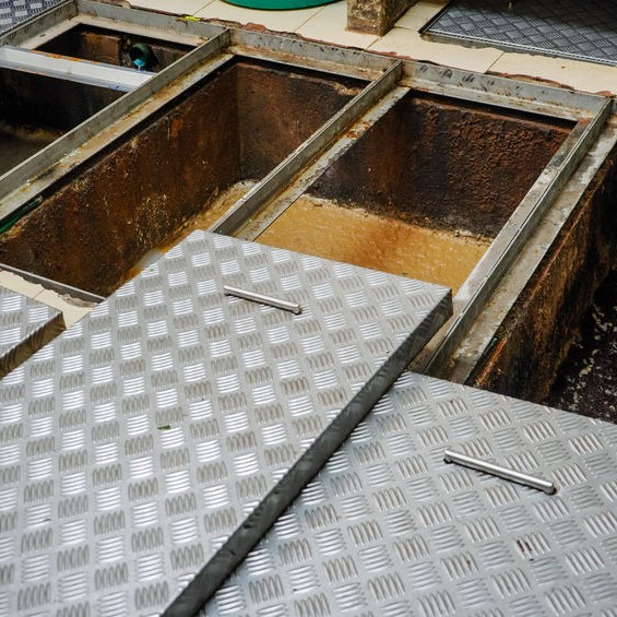 grease traps in need of cleaning