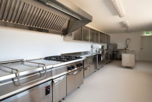 A New Kitchen With Stainless Steel Appliances